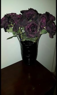 Purple glass vase with flowers  Columbia, 21045