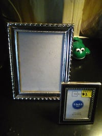 Silver 5 by 7 picture frame and a two and a half b Prairieville, 70769