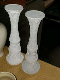 two white ceramic candle holders
