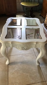 white wooden framed glass top side table