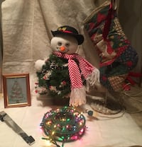 Singing Snowman Lot Singing Snowman,  tree lights up,  he dances & his eyes move!   Hedgesville, 25427