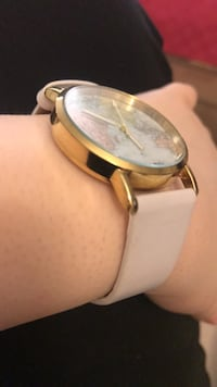 White and Gold World Watch London, N5X 2W8