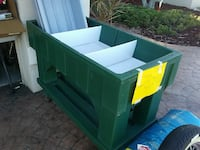 green and white plastic tool chest