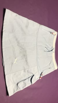 Girls Puma sport skirt.  (Size M) light blue