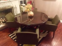 round brown wooden table with four chairs dining set Markham, L3P 6X4
