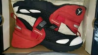 pair of red-and-black Nike basketball shoes 24 mi