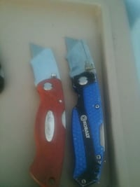 red and blue pocket knives