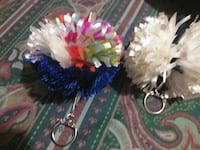 two white and blue puff keychains