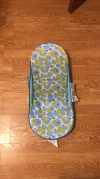 baby's white and blue frog print bather