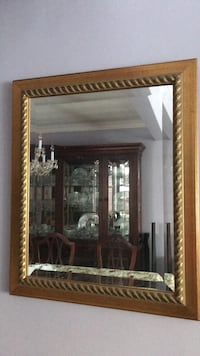 Mirror in a gold frame. Mahogany wood frame mint condition and beveled mirror glass. Size 18.1/2 Wide by 23.3/4 Hight. Put in your home a great decorating Toronto, M8Y 1N7