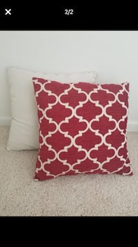 4 pillows. 2 solid light color an 2 red and off white. Lightly used. 18x18 Woodbridge, 22191