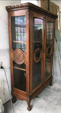brown wooden framed glass display cabinet Miami, 33142