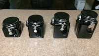 four black ceramic canisters