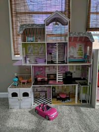 pink and brown wooden dollhouse Odenton