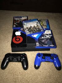 Black sony ps4 with two dualshock 4's and assorted game case s Hyattsville, 20782