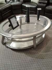 round clear glass top coffee table with brown wooden base