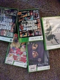 five Xbox 360 game cases