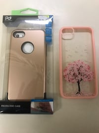 gold-colored iphone case and pink tree iphone case