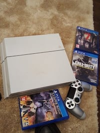 White sony ps4 console with controller and game cases Trenton, 08619