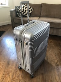 Large Samsonite silver hard plastic spinner luggage extendable New York, 10014