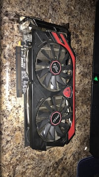 Red and black graphics card. Was used in pc for about 5 months