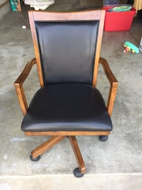 brown wooden framed black leather padded rolling chair Johnstown, 43031
