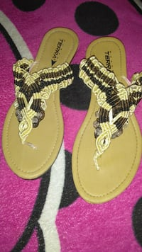 pair of brown-and-black leather sandals Phoenix