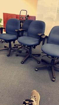 four blue padded rolling armchairs Brooklyn Center, 55430