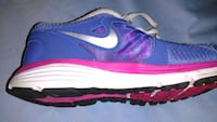 pair of purple-and-pink Nike running shoes Asheville