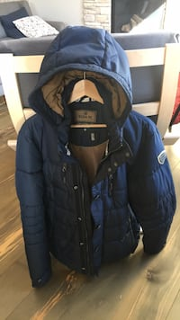 Brand new man winter jacket with hoodie.. original price 250 euros.. size large . Calgary, T3M 0N1
