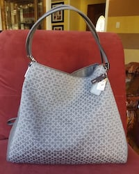 Coach bag. New with tag Coach shoulder bag. Very roomy with lots of compartment. Measurements 13 heights X 12.5 width X 4.5 Bottom in inches. This is a beautiful and classy bag. A good gift for someone or yourself. Original price is $358. Make me and offe Gaithersburg, 20879