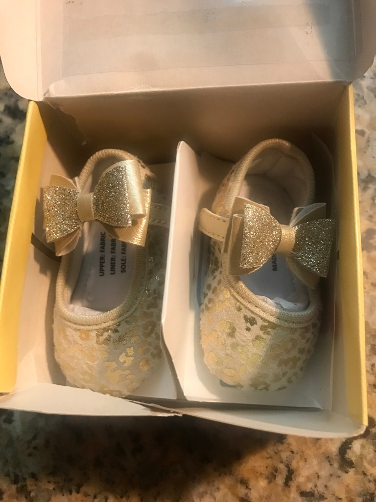 Girl's pair of gold-and-beige mary janes