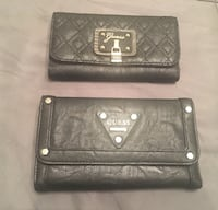 Guess Wallets..brand new $20 each.  557 km