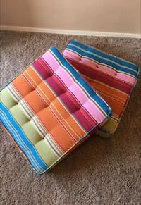 Pink blue and orange chair cushion