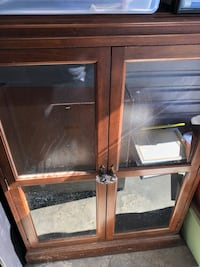 brown wooden framed glass cabinet Euless, 76039