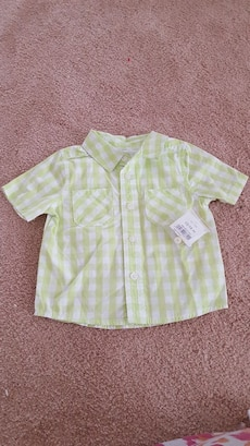 white and green checkered print button-up collared