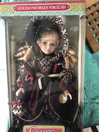 Black and brown dressed porcelain doll
