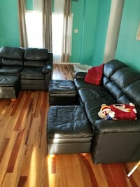 Black sofa with loveseat and 3 ottomans  Millersville