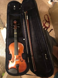 brown violin with bow in case New York, 10301