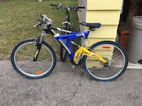 blue and yellow full-suspension bike