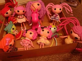 A lot of 14 La La Loopsy dolls and a trike