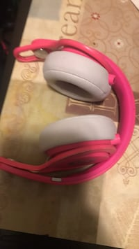 white and pink wireless headphones Detroit
