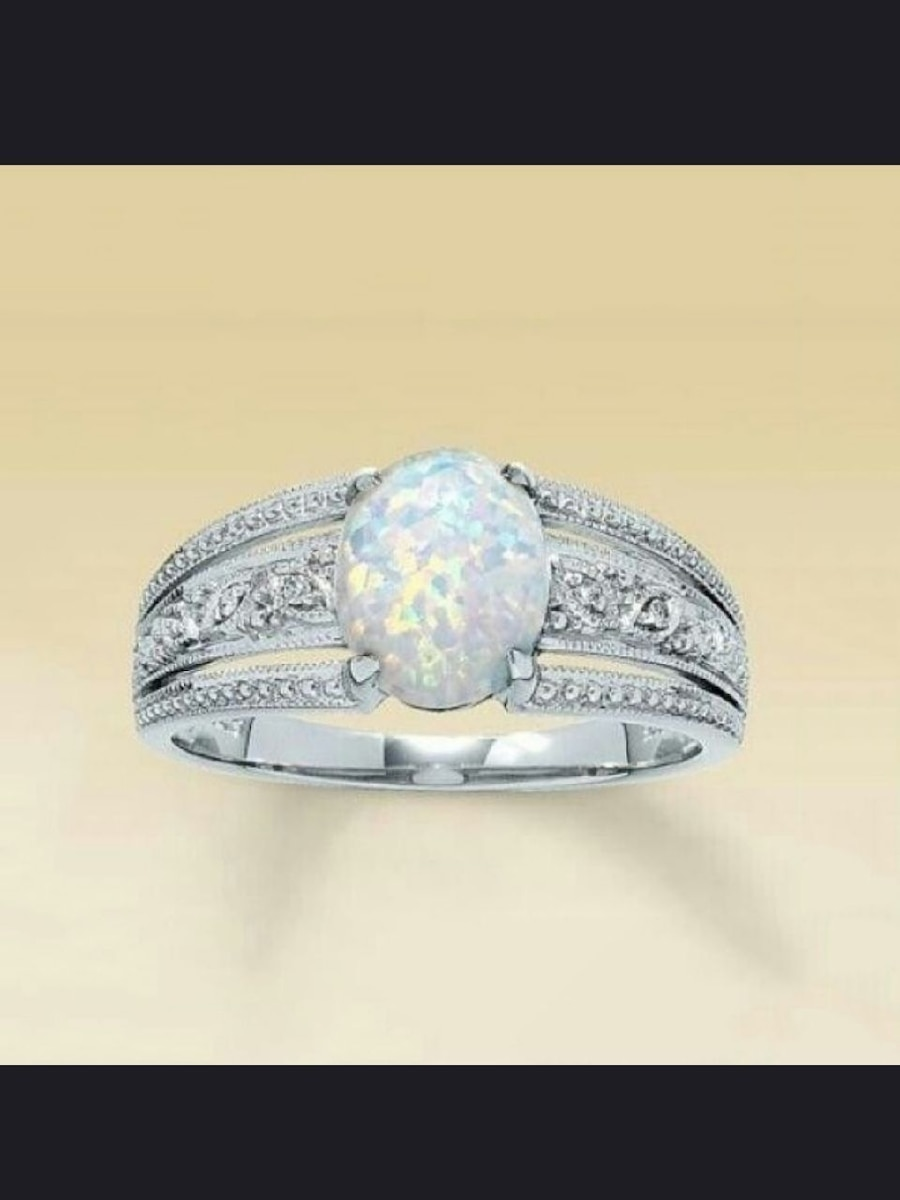 Photo 925 Silver and Fire Opal Ring Size 6