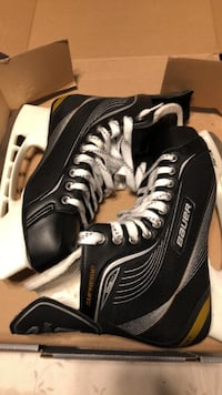 pair of black-and-white Bauer ice skates Rockville, 20853