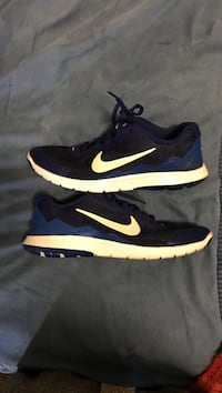 black-and-blue Nike running shoes