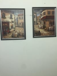 two outside a restaurant painting with black wooden frames