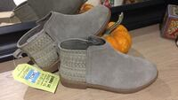 Brand new TOMS youth size 2.5 short boots