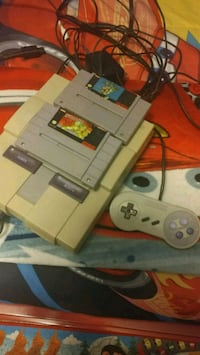 gray Nintendo game console with game cartridges Mesquite, 75150