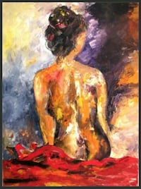 naked woman sitting on cushion painting