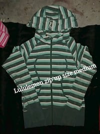 white and green striped polo shirt 3018 km